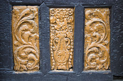 Ancient wood carving on door background Royalty Free Stock Images