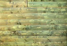 Ancient wood with cracked paint of green color Royalty Free Stock Images