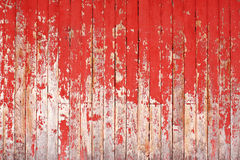Ancient wood with cracked paint of red color Stock Photography