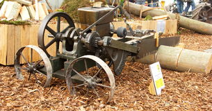 Ancient wood cutting machine. Picture of an old cutting machine with steel saw stock image
