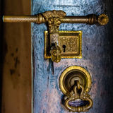 Ancient wood door with metal carved bolt and lock stock photo