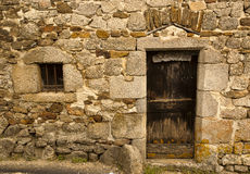 Ancient wood door Saint-Mamet-la-Salvetat Royalty Free Stock Images
