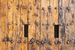 Ancient wood front door royalty free stock photography