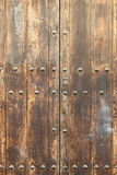 Ancient wood front door Royalty Free Stock Image