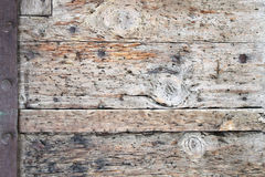 Ancient wood with metal rivets Stock Photography