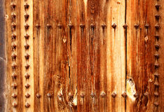 Ancient wood with rivets Stock Photography