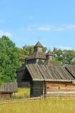 Ancient wooden barn and church Stock Photos