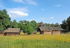 Ancient wooden barn and church Royalty Free Stock Photography