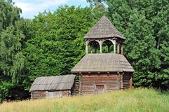 Ancient wooden barn and church Stock Images