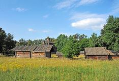 Ancient wooden barn and church Royalty Free Stock Photo