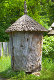 Ancient wooden beehive Stock Images