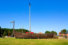 Ancient wooden boat on the grass. Sturmai village, Lithuania Royalty Free Stock Images