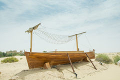 Ancient wooden boat on the sand in the desert Stock Photo