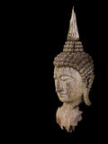 Ancient wooden Buddha statue head isolate Stock Photo