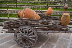 Ancient wooden carriage with clay wine jugs royalty free stock photo