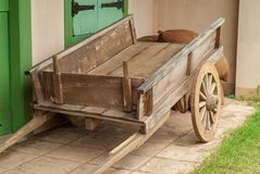 Ancient wooden cart as decoration in front of the house royalty free stock photo