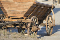 Ancient Wooden cart on a bright day. Ancient Wooden cart on a bright sunny day Royalty Free Stock Photo
