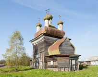 Ancient wooden church in Arkhangelo village, North Russia Stock Images
