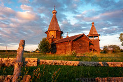 Ancient wooden church in Saunino village near Kargopol at sunrise, Russia Stock Image