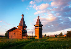 Ancient wooden church in Saunino village near Kargopol at sunrise, Russia Royalty Free Stock Images