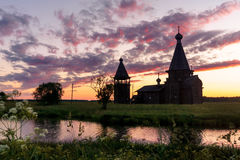 Ancient wooden church in Saunino village near Kargopol at sunrise, Russia Royalty Free Stock Photos