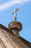 Ancient wooden dome with cross of christian church Stock Photo