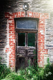 Ancient wooden door in abandoned house Royalty Free Stock Photos