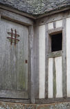 Ancient Wooden Door. Architectural detail of wooden door and window at Mont St Michel Abby Stock Photo