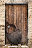 Ancient wooden door and big rusted lock Royalty Free Stock Image