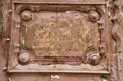 Ancient wooden door fragment. Royalty Free Stock Image