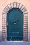 Ancient wooden door of historic building Stock Photos