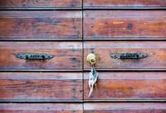 Ancient wooden door with a key chains hanging on the door. In Civita di Bagnoregio, Italy royalty free stock images