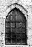 Ancient wooden door leading into Palais des Archeveques at Narbo Royalty Free Stock Images