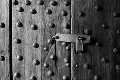 Ancient wooden door and lock Stock Photos