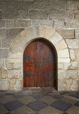Ancient wooden door in old stone castle in Guimaraes Royalty Free Stock Images