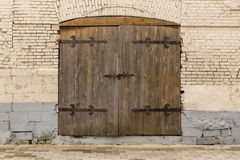 Ancient wooden door in old stone castle wall Royalty Free Stock Photo