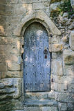 Ancient wooden door in old stone castle wall, Knaresborogh Stock Images