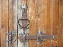 Ancient wooden door rustic metallic detail Royalty Free Stock Photo
