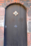 Ancient wooden door with stone frame. European style Stock Photos