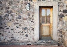 Ancient wooden door with street lamp Stock Photo