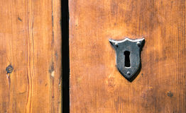 Ancient wooden door whit metal lock, Florence, Italy Stock Photos