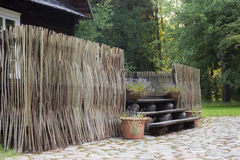 Ancient wooden fence in a rural homestead Stock Photos