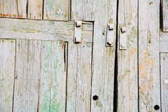 Ancient wooden fence with vertical and horizontal boards stock image
