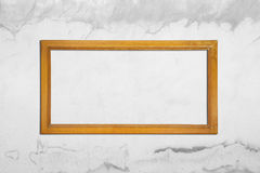 Ancient wooden frame on gray cement wall cracked. Retro style Royalty Free Stock Photos