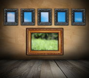 Ancient wooden frames on grunge wall Royalty Free Stock Photo