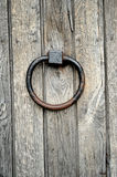 Ancient wooden gate with door knocker Royalty Free Stock Image