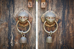 Ancient wooden gate two door knocker rings. Royalty Free Stock Photo