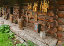 Ancient wooden house from Ukraine. Ancient wooden house with rural tools from Ukraine stock photo