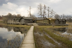Ancient wooden houses in Latvia. Open-air museum in Araisi,Latvia. The wooden island village reconstructed in the end of 20th century Royalty Free Stock Image