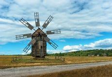 Ancient wooden mill in autumn field. Ukraine, Kiev, Porogovo Royalty Free Stock Image
